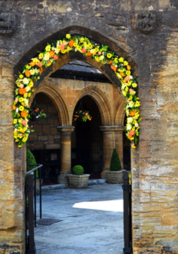 Sherborne - St Johns Almshouses - floral tribute to both St Johns.jpg